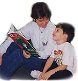 Mom and child read Kelly Bear book
